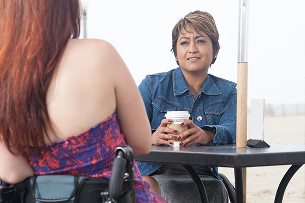 Two people talking at a coffee shop